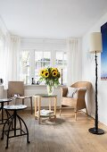 Vase of sunflowers in living room with lattice windows