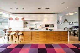 Huge island counter in modern, open-plan kitchen