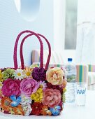 Basket bag decorated with artificial flowers