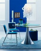 Modern furniture and blue wall in dining room in shades of blue