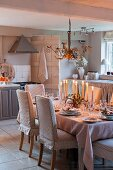 Festively set dining table in kitchen