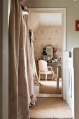 View from hallway to dressing table with Baroque armchair