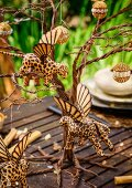 Table set for Christmas dinner in garden with elegant African-style decorations