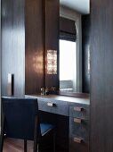 Dressing table integrated in dark wooden wardrobes