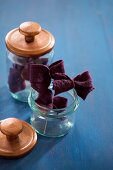 Felt bows in storage jars with lids