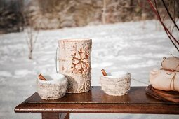 Wooden candle lantern and cups wrapped in wool for winter picnic