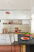 High wall units and dining area in small kitchen