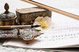 Vintage, artisanal writing utensils, sheet music and hellebore flower