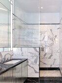 Elegant marble bathroom with shower area