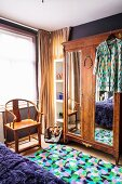 Old wooden chair and antique wardrobe in bedroom