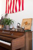Piano, vintage roller skates and houseplant