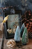 Festive still-life arrangement of Christmas-tree ornaments and picture frame