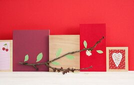 Arrangement of flowering cherry branch and wooden boards with various designs