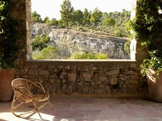 Wicker chair on Mediterranean veranda with a view