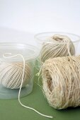 Reels of string in clear plastic pots