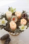 Vintage Advent wreath with numered candles and hellebore flowers