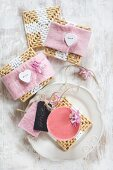 Raffia coasters with pink felt covers and heart-shaped buttons