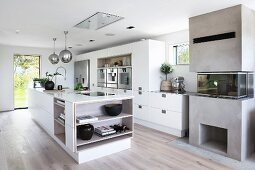 Free-standing counter in white designer kitchen