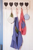 Aprons hand-made from red and blue checked linen