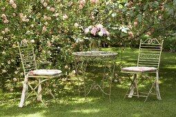 Romantic retreat in flowering rose garden