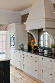White country-house kitchen with vintage charm and black Silestone worksurface