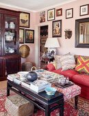 Gallery of pictures and ethnic art in eclectic living room