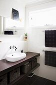 Modernized bathroom with vanity top and white countertop basin