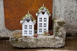 Two house ornaments with houseleeks on roofs