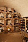 Masonry wine rack and wooden wine rack in wine cellar