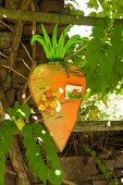 Hand-made carrot-shaped magnetic memo board in garden