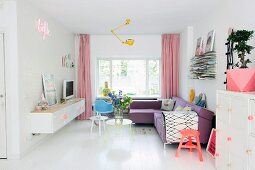 Living area in pastel shades with white wooden floor
