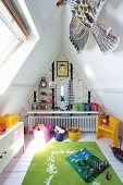 Toys in boy's attic bedroom with skylights