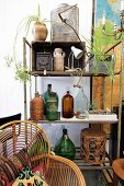 Collection of bottles and other flea-market finds on vintage metal shelving