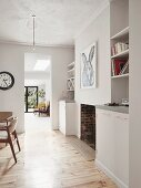 Fitted cupboards and shelving elements in living area
