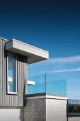 Contemporary house with glass balcony balustrade
