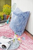 A homemade woven cushion with fringing