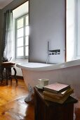 White, free-standing bathtub with wall-mounted taps in bathroom of 19th-century Italian villa