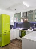 Translucent cupboards and retro fridge in modern kitchen