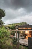 Stormy weather over wooden house with terrace