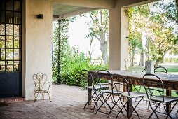 Large table and view into garden from Mediterranean terrace