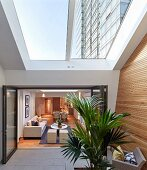 View into living room from modern conservatory