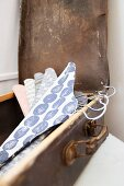 Fabric-covered coathangers in suitcase