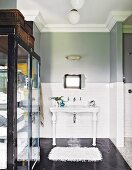 Two-tone wall and cabinet with glass doors in vintage-style bathroom