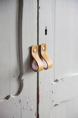 Vintage wardrobe with leather loops as handles