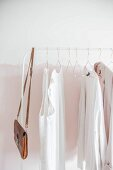 Women's clothing on white clothes rail