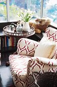 Armchair with patterned upholstery next to windows