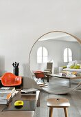 Large round designer mirror in living area