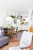 Dining table and kitchen in vintage-style open-plan interior
