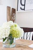 Vase of hydrangeas on wooden table