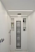 Rainfall shower in white designer bathroom